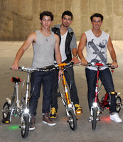 Jonas Brothers with the VeloMini Electric Folding Bicycle